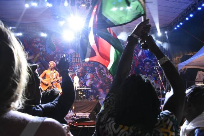 Kenyan flag in air during Fadhilee's Sauti Za Busara performance
